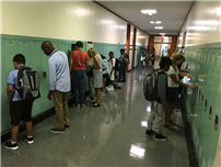 6th Graders Practicing Opening Their Lockers photo